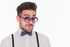 Smiling hipster man in studio Royalty Free Stock Photos