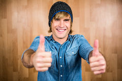 Smiling hipster with thumbs up Stock Photography