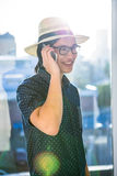 Smiling hipster using his phone Royalty Free Stock Photos