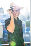 Smiling hipster using his phone Stock Photography