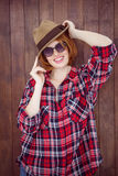 Smiling hipster wearing a trilby and sunglasses Stock Photo