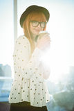 Smiling hipster woman drinking coffee Stock Photos