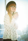Smiling hipster woman drinking coffee Stock Image