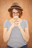 Smiling hipster woman drinking a  cup of coffee Stock Photo