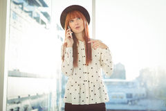 Smiling hipster woman having a phone call Stock Photos