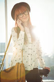 Smiling hipster woman having a phone call Stock Image