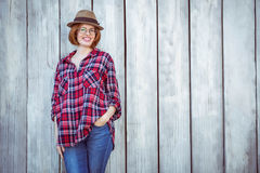 smiling hipster woman with her hand in her pocket Stock Images