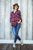 smiling hipster woman with her hand in her pocket Stock Image