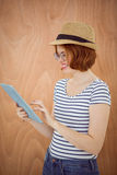 smiling hipster woman on her tablet computer Royalty Free Stock Images