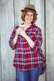 Smiling hipster woman holding a coffee cup Stock Photography