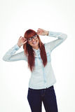 Smiling hipster woman holding her glasses Stock Images