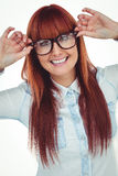 Smiling hipster woman holding her glasses Royalty Free Stock Photography