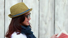 Smiling hipster woman reading a book stock video footage