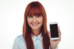 Smiling hipster woman showing her smartphone Stock Photo