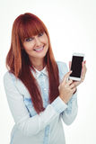 Smiling hipster woman showing her smartphone Stock Photography