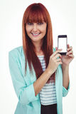 Smiling hipster woman showing her smartphone Stock Photos
