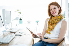 smiling hipster woman on a tablet Royalty Free Stock Photography