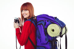Smiling hipster woman with a travel bag. Against white background Royalty Free Stock Photo