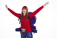 Smiling hipster woman with a travel bag. Against white background Stock Photo