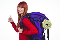 Smiling hipster woman with a travel bag. Against white background Royalty Free Stock Photos