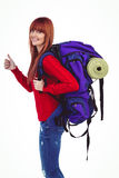 Smiling hipster woman with a travel bag. On her back Royalty Free Stock Photo