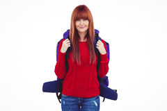 Smiling hipster woman with a travel bag taking selfie. Against white background Royalty Free Stock Photography