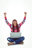 Smiling hipster woman using laptop while putting hands up Royalty Free Stock Image