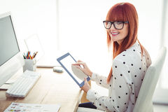 Smiling hipster woman using tablet Royalty Free Stock Images
