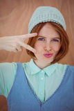 Smiling hipster woman wearing a beanie hat Royalty Free Stock Photos
