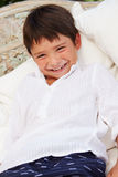 Smiling Hispanic Boy At Home Sitting On Outdoor Seat� Royalty Free Stock Photography