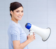 Smiling hispanic businesswoman holding a megaphone Stock Images