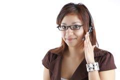 Smiling Hispanic Call Center Employee. Latino Customer Service Woman with Headset royalty free stock photos