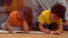 Smiling Hispanic children doing their homework in the living room