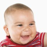 Smiling hispanic male baby. Stock Photo