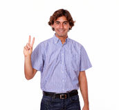 Smiling hispanic man with finger victory gesture Royalty Free Stock Image