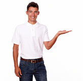 Smiling hispanic man standing holding his palm Royalty Free Stock Photography