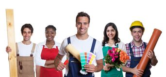 Smiling hispanic painter with group of other international appre Royalty Free Stock Image