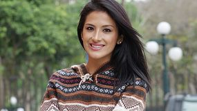Smiling Hispanic Woman In Park Stock Photos