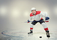 Smiling hockey player on ice Stock Photography
