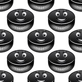 Smiling hockey pucks seamless pattern Royalty Free Stock Images