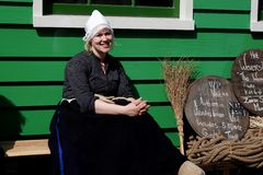 Smiling holland women. Smiling women in Zaanse Schans ethnographic museum in Netherlands royalty free stock photo