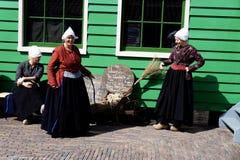 Smiling holland women. In Zaanse Schans ethnographic museum in Netherlands stock images