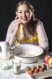 Smiling homemaker in kitchen Royalty Free Stock Images