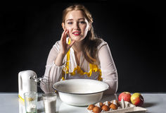 Smiling homemaker in kitchen Stock Images