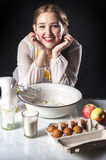 Smiling homemaker in kitchen Stock Image