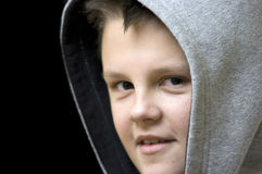 Smiling hooded boy Stock Photography