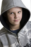Smiling hooded teenage boy Stock Photos