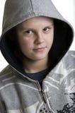 Smiling hooded teenage boy Stock Photos