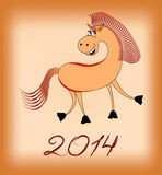 Smiling  horse in 2014 on a beige background Royalty Free Stock Photo