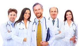 Smiling hospital colleagues standing together Stock Photos